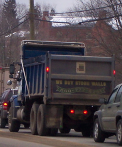 "This truck drives by the highway with the brazen solicitation of ""We Buy Stone Walls."""