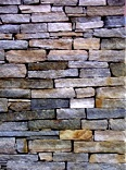 Carefully laid wall of tablet-shaped stones of granite gneiss. Characteristic of new construction.